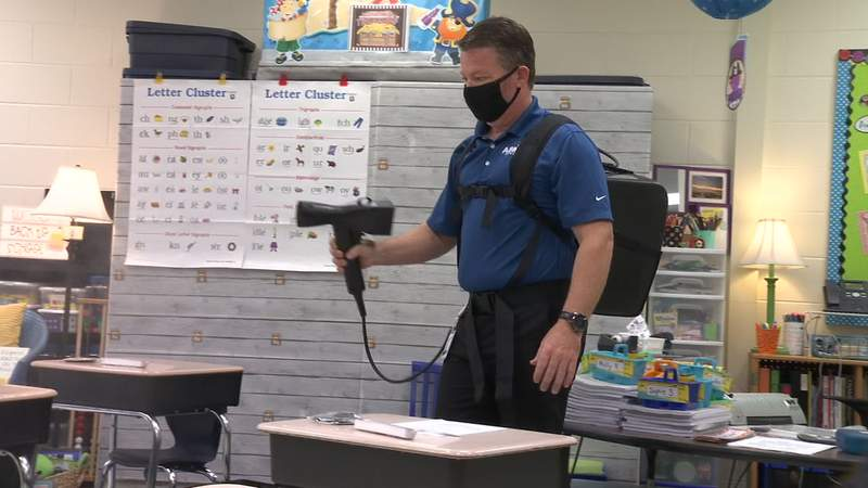 A staff member cleans in a Duval County Public Schools classroom