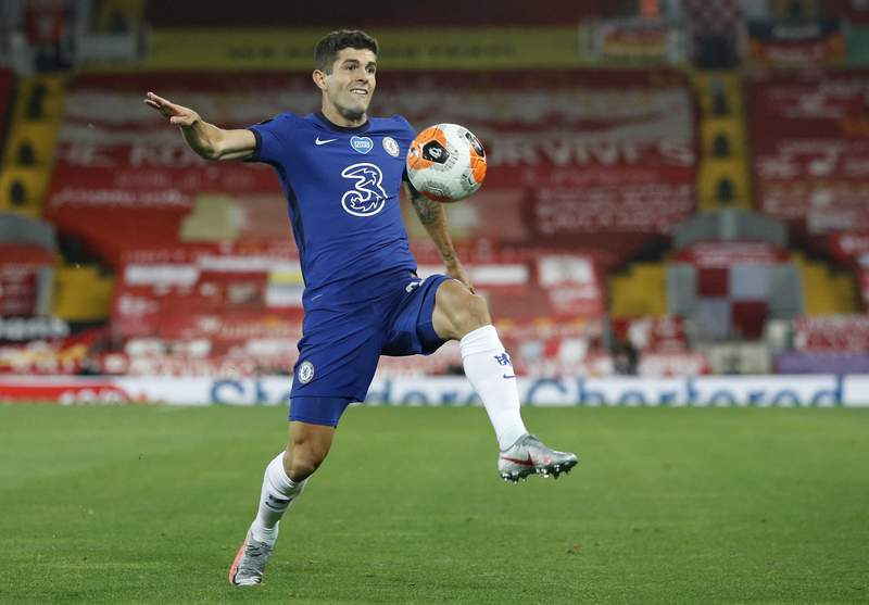 FILE - In this Wednesday, July 22, 2020 file photo, Chelsea's Christian Pulisic controls the ball during the English Premier League soccer match between Liverpool and Chelsea at Anfield Stadium in Liverpool, England. Frank Lampards squad has certainly seen the most intriguing changes ahead of the new campaign - having been banned from signing players last summer, they have looked to make up for lost time and recruited some big names to replace long-term servants such as Pedro and Willian. (Phil Noble/Pool via AP, file)