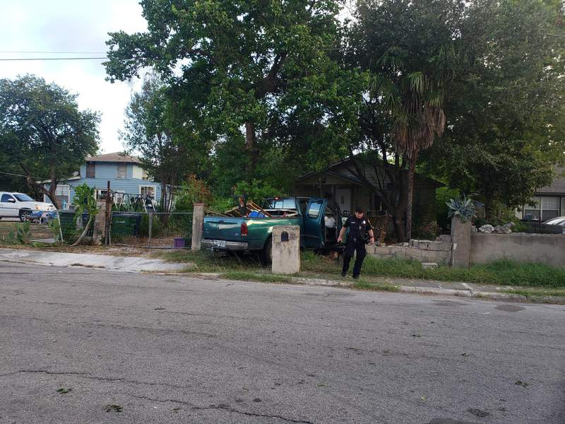 San Antonio police say a driver of a stolen truck crashed into a concrete wall outside a home near the intersection of Benrus Boulevard and Rita Avenue on the West Side Thursday morning. The driver had been involved in a hit-and-run just moment before.
