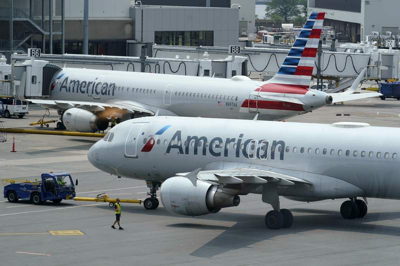 American Airlines passenger jets prepare for departure, Wednesday, July 21, 2021, near a terminal at Boston Logan International Airport, in Boston. American Airlines Group Inc. (AAL) on Thursday, July 22 reported second-quarter net income of $19 million, after reporting a loss in the same period a year earlier. (AP Photo/Steven Senne)