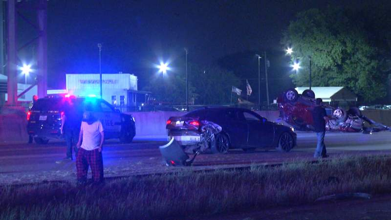 An SUV hit an off-duty officer's vehicle around 3 a.m. on the access road of Interstate 35 near South Zarzamora Street on the city's Southwest Side.
