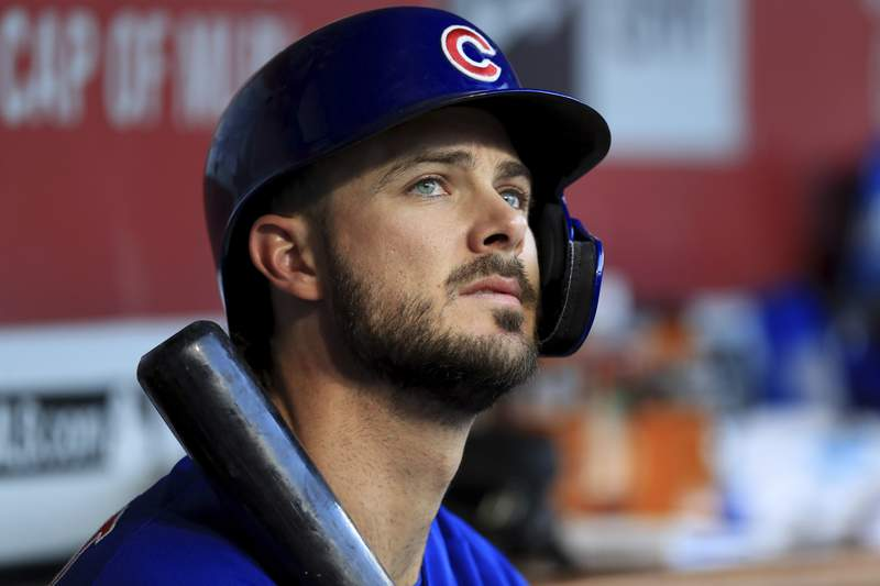 FILE - In this Aug. 10, 2019, file photo, Chicago Cubs' Kris Bryant (17) sits in the dugout during a baseball game against the Cincinnati Reds in Cincinnati. The All-Star third baseman has lost his service-time grievance against the Cubs, two people with direct knowledge of the situation told The Associated Press on Wednesday, Jan. 29, 2020. (AP Photo/Aaron Doster, FIle)