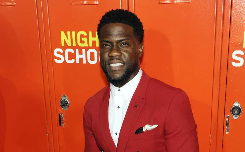 """FILE - Kevin Hart, a cast member, producer and co-writer of """"Night School,"""" poses at the premiere of the film Sept. 24, 2018, in Los Angeles. Hart will debut his new SiriusXM original podcast with Jerry Seinfeld as the series' inaugural guest. The satellite radio company announced Wednesday, Jan. 27, 2021, the launch of Hart's """"Inside Jokes with Kevin Hart."""" (Photo by Chris Pizzello/Invision/AP, File)"""