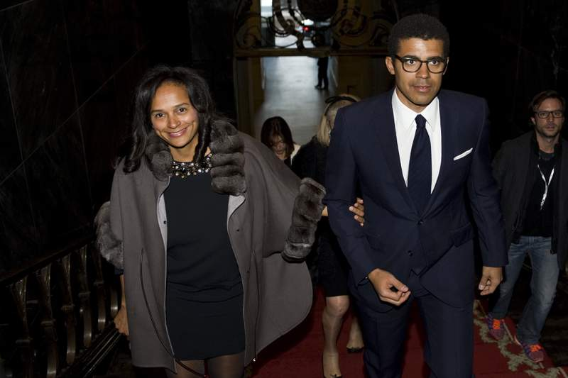 FILE - In this March 5, 2015, file photo, Isabel dos Santos, reportedly Africa's richest woman, and her husband and art collector, Sindika Dokolo, arrive for a ceremony at the City Hall in Porto, Portugal. Police in Dubai said Sunday, Nov. 1, 2020, they don't suspect foul play in the death of Dokolo, the husband of the embattled Angolan billionaire dos Santos, after his death free diving off the city-state as corruption allegations circle both him and his wife. (AP Photo/Paulo Duarte, File)