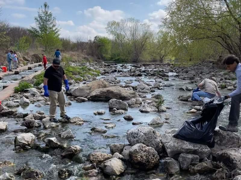 San Antonio River Aid volunteers clean up trash on Mission Reach.