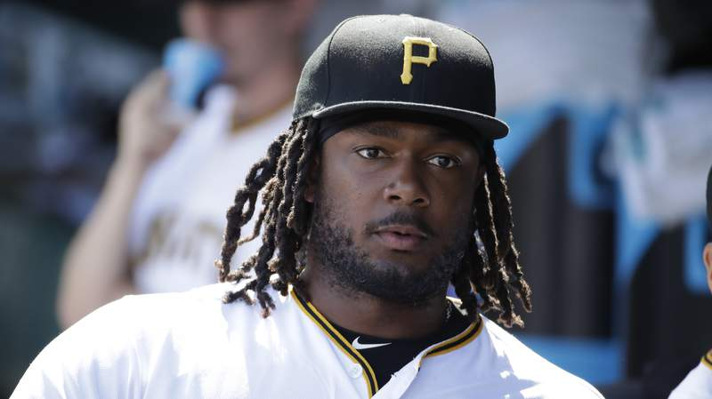 """FILE - In this  Saturday, June 22, 2019 file photo, Pittsburgh Pirates' Josh Bell waits to take the field for the team's baseball game against the San Diego Padres in Pittsburgh. Pirates first baseman Josh Bell watched George Floyd's death in horror. Rarely one to talk, Bell prefers to have his actions speak for him. Bell, who is Black, has started a book club and a weekly """"Social Reform Sunday"""" movement on Instagram where he attempts to highlight one of the may issues surrounding the fight for racial (AP Photo/Gene J. Puskar, File)"""