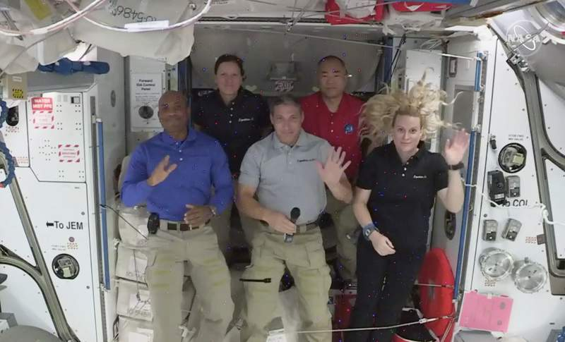 Crew -1 NASA astronauts from left to right pilot Victor Glover, mission specialist Shannon Walker, Crew Dragon commander Michael Hopkins,  Japan Aerospace Exploration Agency (JAXA) astronaut and mission specialist Soichi Noguchi and flight engineer Kate Rubins hold a news conference from aboard the International Space Station on Thursday, Nov. 19, 2020.  (NASA via AP)