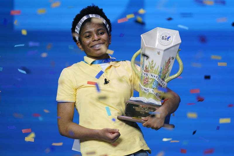 Zaila Avant-garde, 14, from Harvey, Louisiana celebrates with the championship trophy after winning the finals of the 2021 Scripps National Spelling Bee at Disney World Thursday, July 8, 2021, in Lake Buena Vista, Fla. (AP Photo/John Raoux)