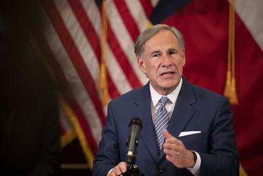 Gov. Greg Abbott announced a strike force in charge of laying steps to re-open the Texas economy at a press conference in the capitol on April 17, 2020.      Miguel Gutierrez/POOL via The Texas Tribune