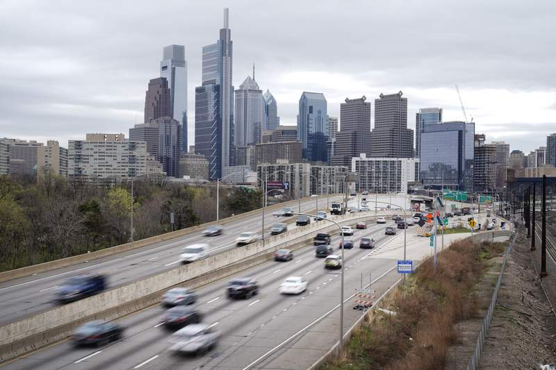 FILE - In this March 31, 2021 file photo, traffic moves along the Interstate 76 highway in Philadelphia.  If you're traveling over the Memorial Day weekend, expect lots of company. The AAA auto club said Tuesday, May 11,  that more than 37 million Americans plan to travel at least 50 miles from home over the holiday weekend.  (AP Photo/Matt Rourke, File)