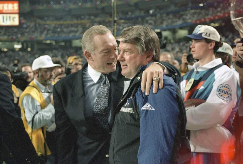 Owner Jerry Jones of the Dallas Cowboys (L) hugs head coach Jimmy Johnson (R) as the Cowboys leads the Buffalo Bills late in the fourth quarter of Super Bowl XXVIII on January 30, 1994 at the Georgia Dome in Atlanta, Georgia. The Cowboys won the Super Bowl 30 -13. (Photo by Focus on Sport/Getty Images)