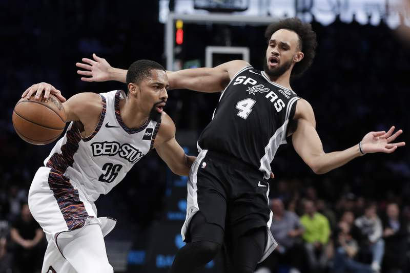 San Antonio Spurs' Derrick White (4) defends Brooklyn Nets' Spencer Dinwiddie (26) during the second half of an NBA basketball game Friday, March 6, 2020, in New York. The Nets won 139-121. (AP Photo/Frank Franklin II)
