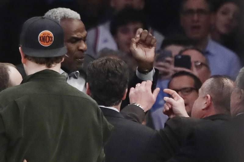 FILE - In this Feb. 8, 2017 file photo, former New York Knicks player Charles Oakley exchanges words with a security guard during the first half of an NBA basketball game between the New York Knicks and the LA Clippers, in New York's Madison Square Garden. A jury can decide whether former New York Knicks star  Oakley was ejected from Madison Square Garden with excessive force when he was removed as a spectator to a 2017 game, an appeals court ruled Monday. (AP Photo/Frank Franklin II, File)
