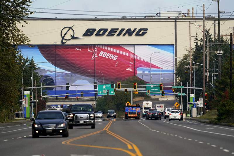 FILE - In this Oct. 1, 2020 file photo, traffic passes the Boeing airplane production plant, in Everett, Wash.  U.S. manufacturers expanded in March 2021 at the fastest pace in 37 years, a sign of strengthening demand as the pandemic wanes and government emergency aid flows through the economy.  (AP Photo/Elaine Thompson, file)
