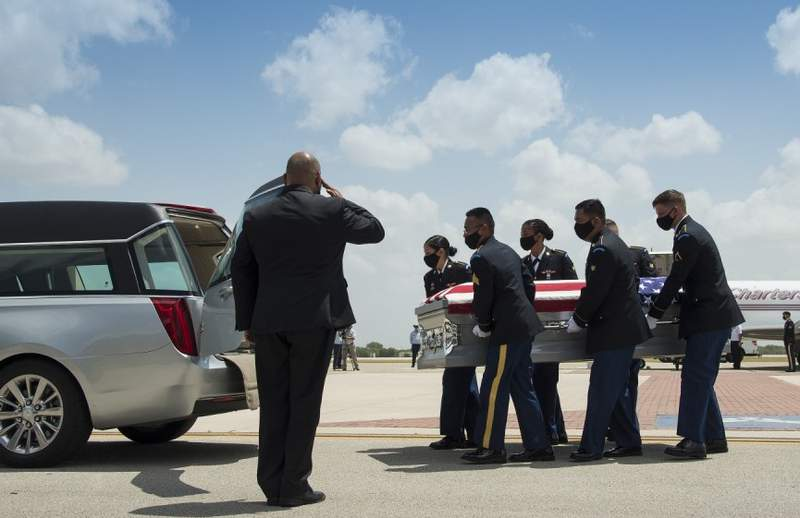 Members of the Ft. Sam Houston Honor Guard carry the remains of Spc. Vincent Sebastian Ibarria, 21, from San Antonio, to a hearse at Joint Base San Antonio-Randolph, TX, July 17, 2020.