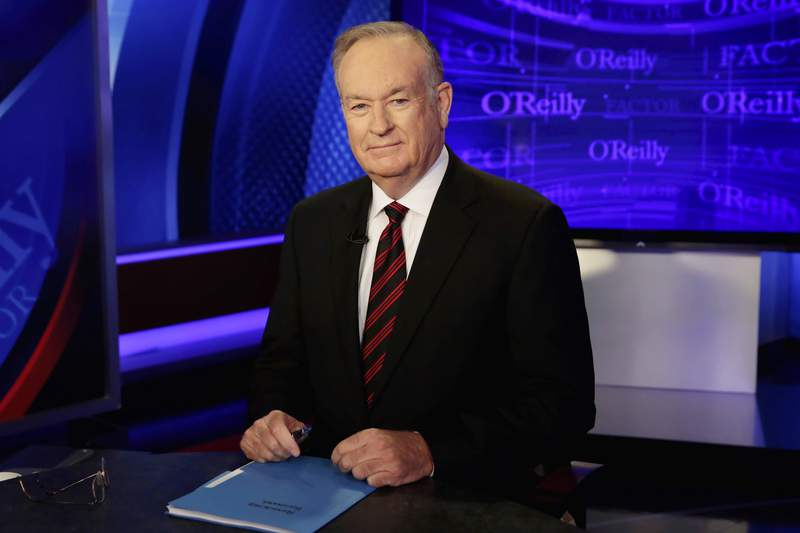 """FILE - In this Thursday, Oct. 1, 2015, file photo host Bill O'Reilly of """"The O'Reilly Factor"""" program, on the Fox News Channel, poses for photos, in New York. The View canceled a planned appearance Wednesday, July 21, 2021, by a woman who settled a sexual harassment lawsuit against O'Reilly, after the former Fox News Channel personality sought and received a restraining order against her. (AP Photo/Richard Drew, File)"""