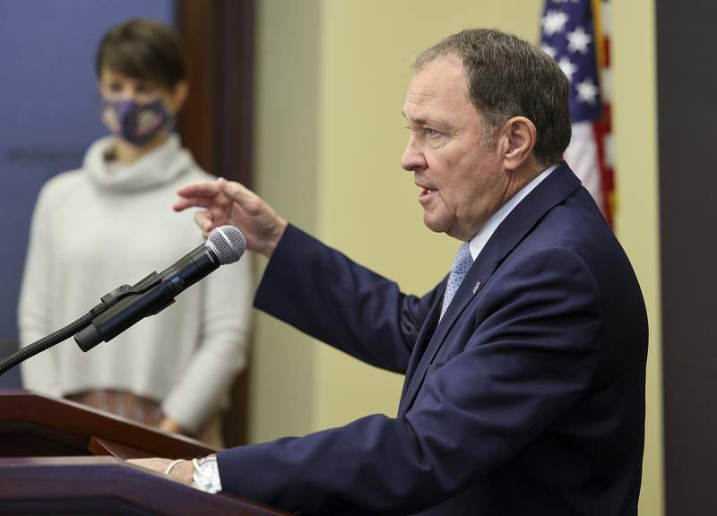 Gov. Gary Herbert speaks as he joins state epidemiologist Dr. Angela Dunn at a news conference at the Capitol in Salt Lake City on Monday, Nov. 9, 2020, clarifying the state's mask mandate. Herbert ordered a statewide mask mandate for the first time late Sunday. He is also pausing extracurricular school activities, along with most sports and social gatherings with people outside the household. (Scott G Winterton/The Deseret News via AP, Pool)