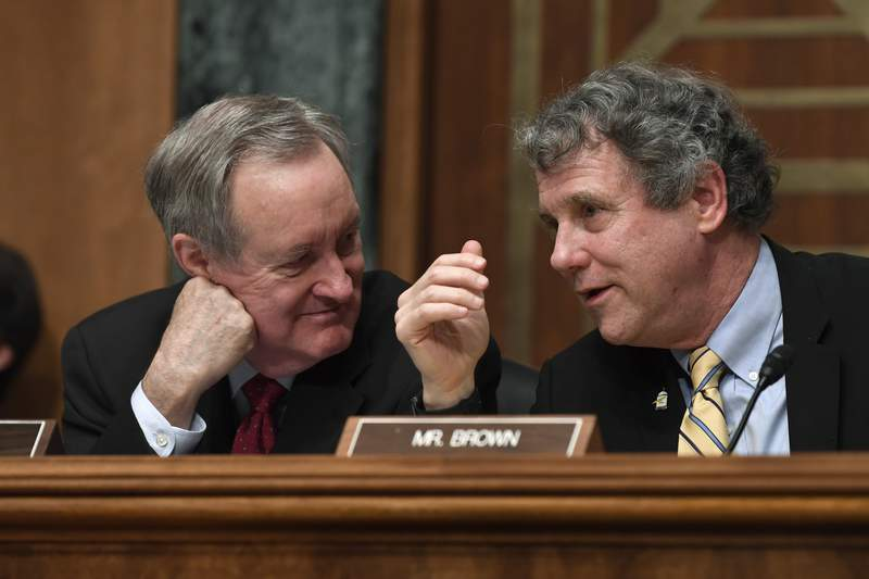 Senate Banking Committee Chairman Sen. Mike Crapo, R-Idaho, left, talks with ranking member Sen. Sherrod Brown, D-Ohio, right, during a hearing with Federal Reserve Chairman Jerome Powell on Capitol Hill in Washington, Wednesday, Feb. 12, 2020. (AP Photo/Susan Walsh)