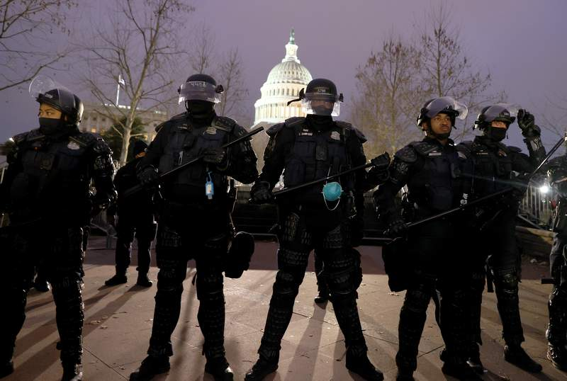Police officers in riot gear line up as protesters gather on the U.S. Capitol Building on Jan. 6, 2021 in Washington, D.C.
