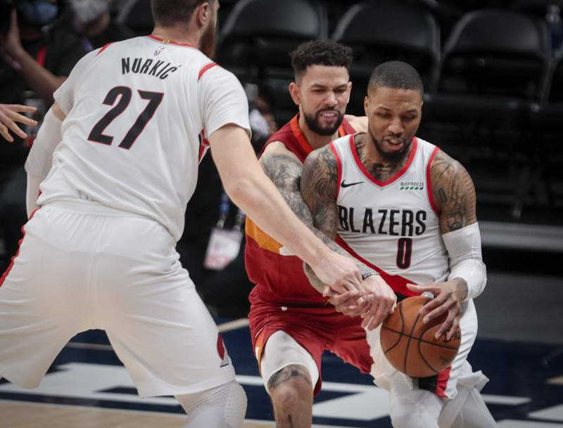 Portland Trail Blazers center Jusuf Nurkic (27) sets a screen against Denver Nuggets guard Austin Rivers as Rivers fouls Trail Blazers guard Damian Lillard (0) in the second quarter of Game 2 of a first-round NBA basketball playoff series Monday, May 24, 2021, in Denver. (AP Photo/Joe Mahoney)