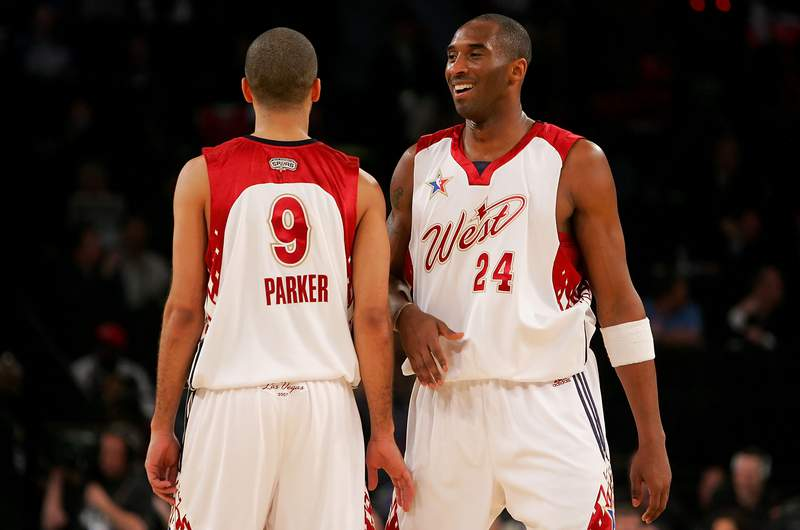 LAS VEGAS - FEBRUARY 18:  Kobe Bryant #24 and Tony Parker  #9 of the Western Conference share a laugh during the 2007 NBA All-Star Game against the Eastern Conference on February 18, 2007 at Thomas & Mack Center in Las Vegas, Nevada.  (Photo by Lisa Blumenfeld/Getty Images)