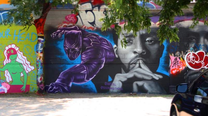 Artists Hatziel Flores and Jeremy Biggers created the nearly 7 x 15 foot wide mural after news broke of Boseman's passing from colon cancer at the age of 43. (Credit: Hatziel Flores)