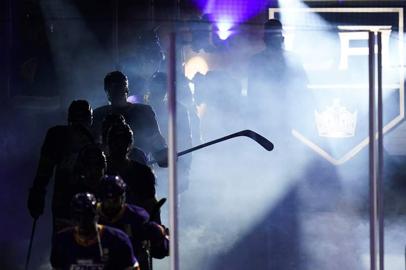 The Los Angeles Kings enter the ice at the start of the third period of an NHL hockey game against the Anaheim Ducks Monday, April 26, 2021, in Los Angeles. (AP Photo/Ashley Landis)