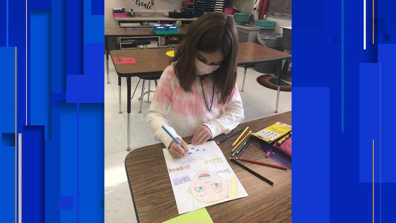 """Ainsley Gilpin, fourth grade student at Arlon Seay Elementary, works on her """"Behind the Mask"""" art piece in Dorothy Runyen's art class."""