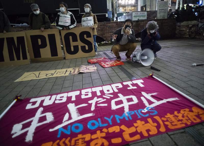 """FILE - In this March 25, 2021, file photo, a """"No Olympics"""" banner is placed by protesters in Tokyo during a demonstration against the going ahead of the Tokyo 2020 Olympic and Paralympic Games. An online petition calling for the Tokyo Olympics to be canceled has gained ten of thousands of signatures since being launched in Japan just a few days ago. The rollout comes with Tokyo, Osaka and several other areas under a state of emergency with coronavirus infections rising  particularly new variants. (AP Photo/Hiro Komae, File)"""