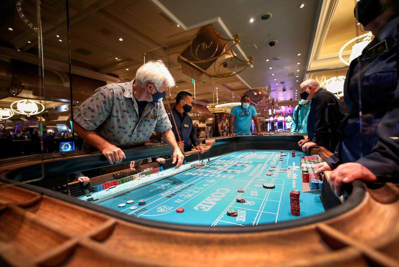 Craps players at the Bellagio hotel and casino in Las Vegas. Lawmakers filed legislation Tuesday seeking to bring casino gambling to Texas. (Credit: REUTERS/Steve Marcus)