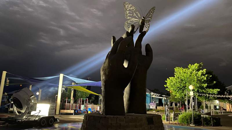 """Morgan's Wonderland unveiled a 25-foot """"Taking Flight"""" sculpture to honor its 10th birthday. The bronze sculpture is at the entrance of the park. It will be illuminated throughout April."""