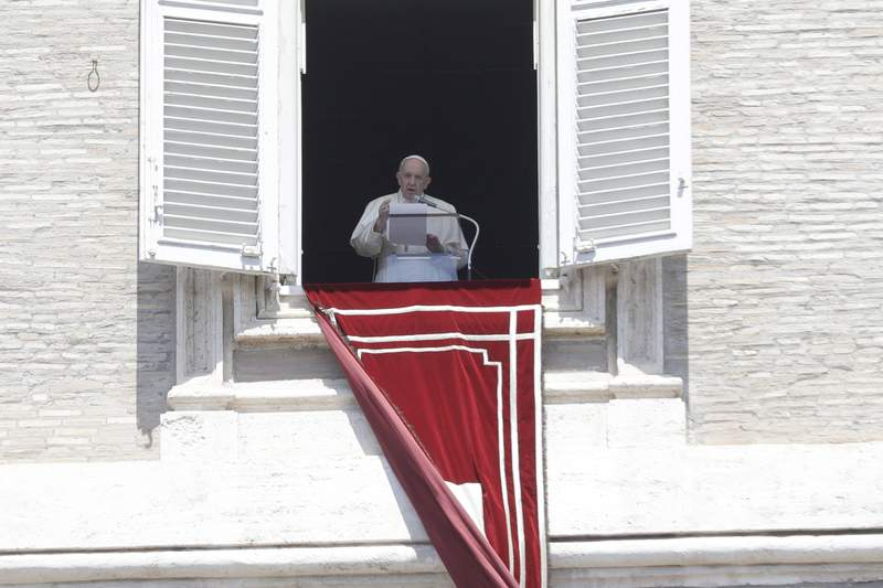 Pope Francis recites the Angelus noon prayer in St. Peter's Square at the Vatican, Sunday, May 9, 2021. (AP Photo/Gregorio Borgia)