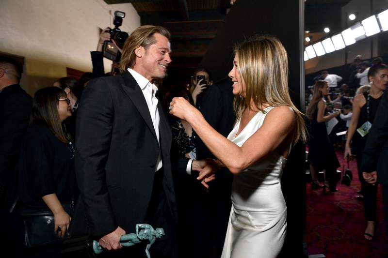 LOS ANGELES, CALIFORNIA - JANUARY 19:  (EXCLUSIVE COVERAGE) Brad Pitt and Jennifer Aniston reunited at the 26th Annual Screen ActorsGuild Awards at The Shrine Auditorium on January 19, 2020 in Los Angeles, California. For fans that loved their marriage, it was WILD to see the couple be friendly with each oter in front of cameras. (Photo by Emma McIntyre/Getty Images for Turner)