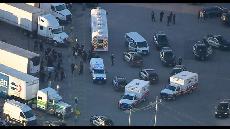 28 in HSI custody, 1 hospitalized after dozens bail out of 18-wheeler at far East Side truck stop, SAPD says