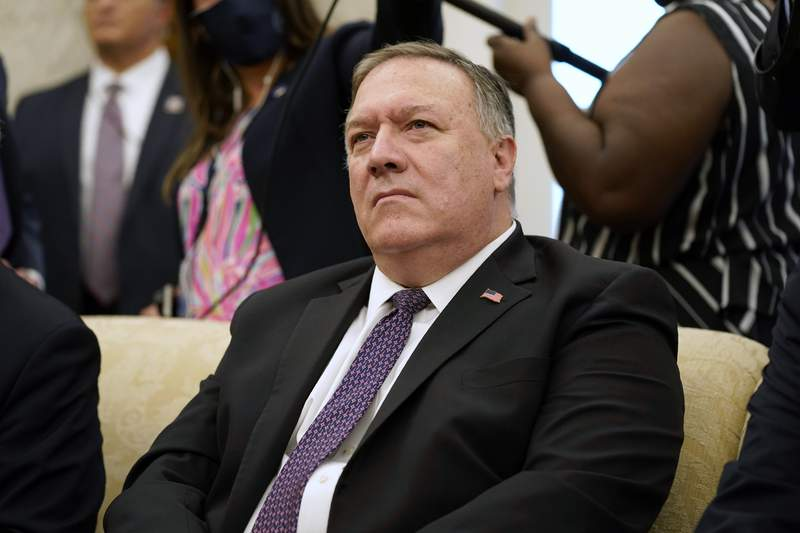 Secretary of State Mike Pompeo listens to a reporter's question during a meeting with President Donald Trump and Iraqi Prime Minister Mustafa al-Kadhimi in the Oval Office of the White House, Thursday, Aug. 20, 2020, in Washington. (AP Photo/Patrick Semansky)