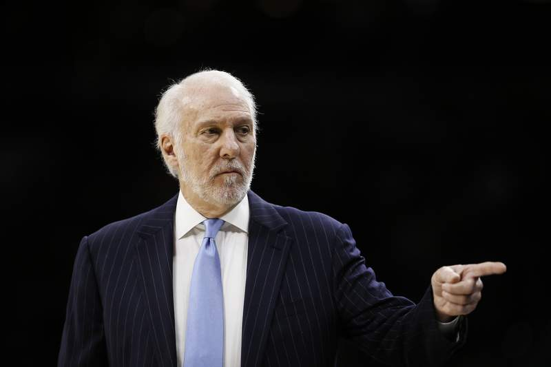 San Antonio Spurs coach Gregg Popovich points to his bench during the first half of the team's NBA basketball game against the Philadelphia 76ers, Friday, Nov. 22, 2019, in Philadelphia. (AP Photo/Matt Slocum)