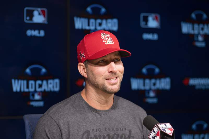 St. Louis Cardinals starting pitcher Adam Wainwright responds to a question during a baseball news conference in Los Angeles, Tuesday, Oct. 5, 2021. The Cardinals play the Los Angeles Dodgers in wild card playoff game on Wednesday.  (AP Photo/Kyusung Gong)
