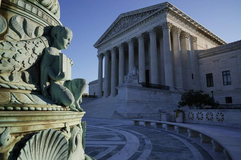 In this Oct. 5, 2020, photo the Supreme Court in Washington. Tech giants Google and Oracle are clashing at the Supreme Court in a copyright dispute worth billions and important to the future of software development. (AP Photo/J. Scott Applewhite)