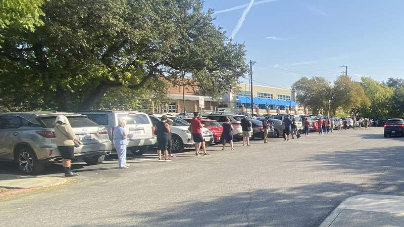 A line of early voters is seen outside the Tobin Library in San Antonio on Tuesday, Oct. 13, 2020, the first day of early voting in Texas.