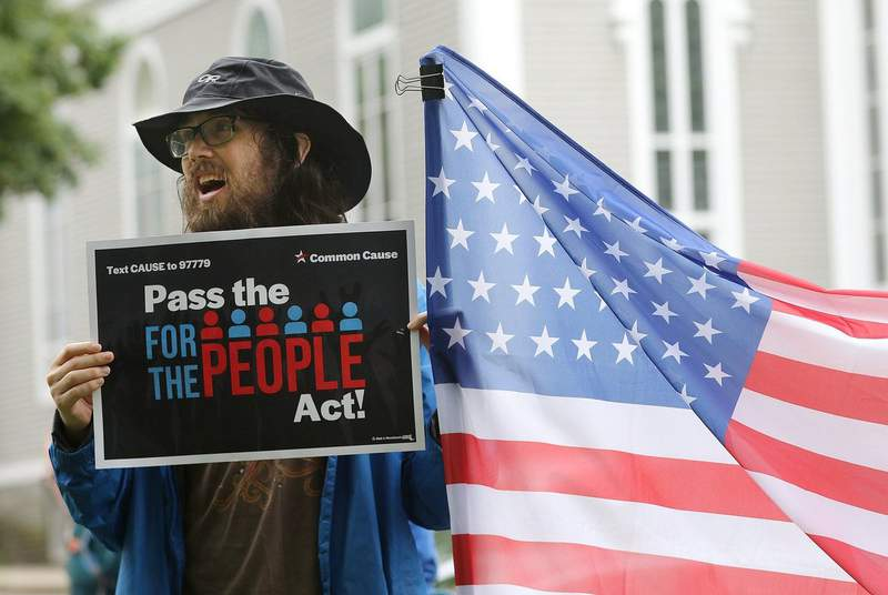 """Jesse W. chanted in support of  the """"For the People Act"""" during a rally in Concord, Massachusetts on July 10, 2021."""