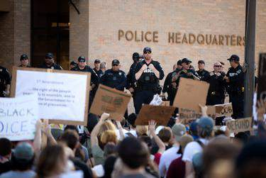 The Austin City Council on Thursday voted to cut the police department's budget by tens of millions of dollars. (Credit: Eddie Gaspar/The Texas Tribune)