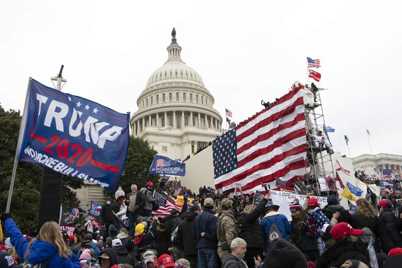 FILE - In this Jan. 6, 2021, file photo, supporters of President Donald Trump stand outside the U.S. Capitol in Washington. (AP Photo/Jose Luis Magana, File)