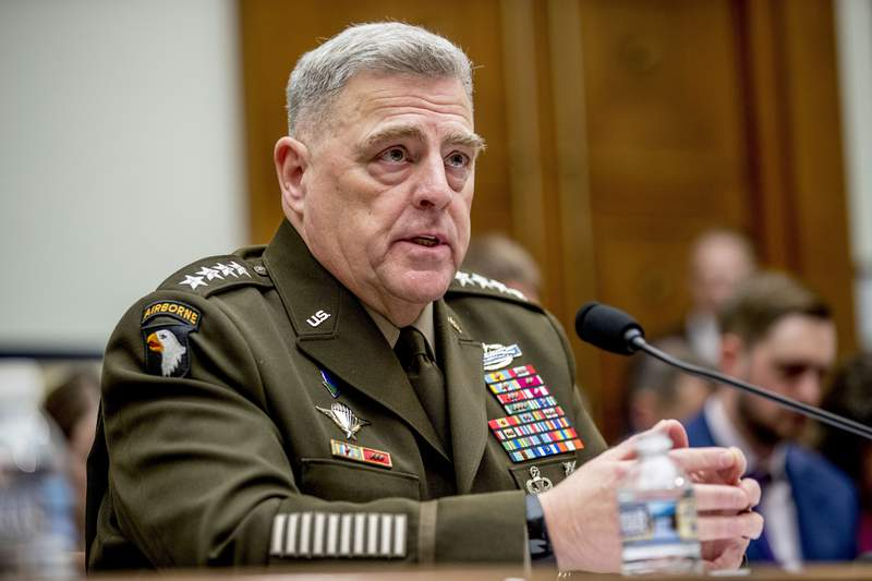 FILE - In this Feb. 26, 2020 file photo, Joint Chiefs of Staff Chairman Gen. Mark Milley speaks at a House Armed Services Committee hearing on Capitol Hill in Washington. The top U.S. military officer is telling Congress that the U.S. armed forces will have no role in carrying out the election process or resolving a disputed vote. The comments from Gen. Mark Milley, chairman of the Joint Chiefs of Staff, underscore the extraordinary political environment in America, where the president has declared without evidence that the expected surge in mail-in ballots will make the vote inaccurate and fraudulent, (AP Photo/Andrew Harnik)