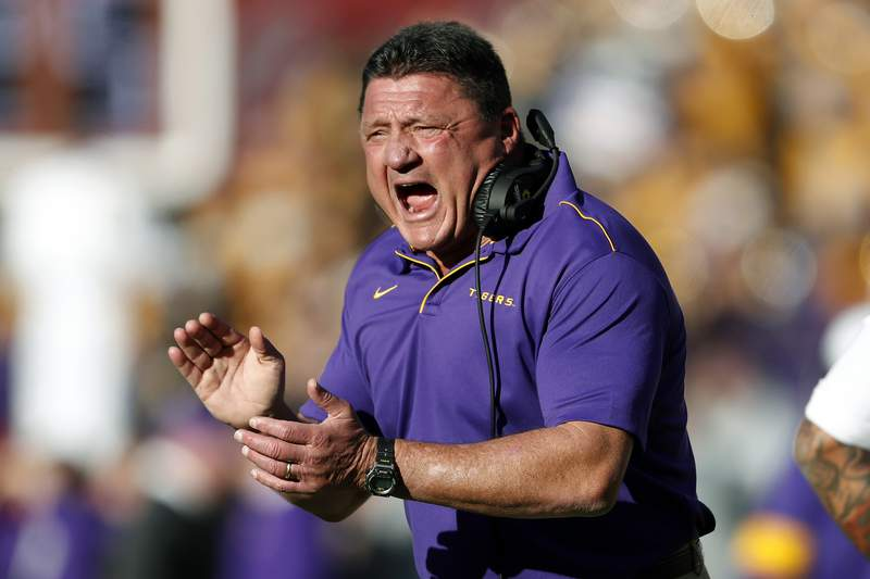 FILE - In this Saturday, Nov. 9, 2019 file photo, LSU head coach Ed Orgeron reacts after a LSU touchdown in the first half of an NCAA football game against Alabama in Tuscaloosa, Ala. This is the rare SEC team whose schedule might have gotten a tad easier by playing a conference-only slate. The SEC opponents added to LSUs schedule last month were Missouri (6-6 last season) and Vanderbilt (3-9). LSU had to drop a scheduled home date with No. 14 Texas, though its other non-conference games would have been lackluster matchups with Rice, Nicholls and Texas-San Antonio. (AP Photo/John Bazemore, File)