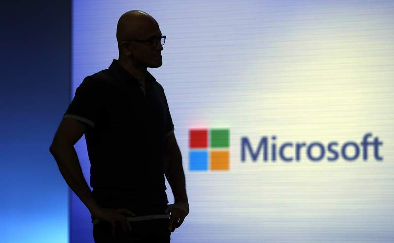 FILE - In this May 7, 2018, file photo, Microsoft CEO Satya Nadella looks on during a video as he delivers the keynote address at Build, the company's annual conference for software developers in Seattle. Microsoft says the coronavirus pandemic has increased demand for its flagship cloud computing and workplace productivity products as it reported quarterly earnings Wednesday, July 22, 2020, that beat Wall Street expectations. (AP Photo/Elaine Thompson, File)