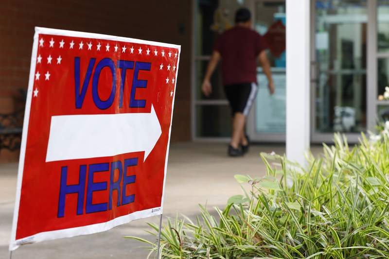 A man heads inside to vote in primary election at Gaines Elementary School in Athens, Ga, on Tuesday, June 9, 2020. (Joshua L. Jones/Athens Banner-Herald via AP)