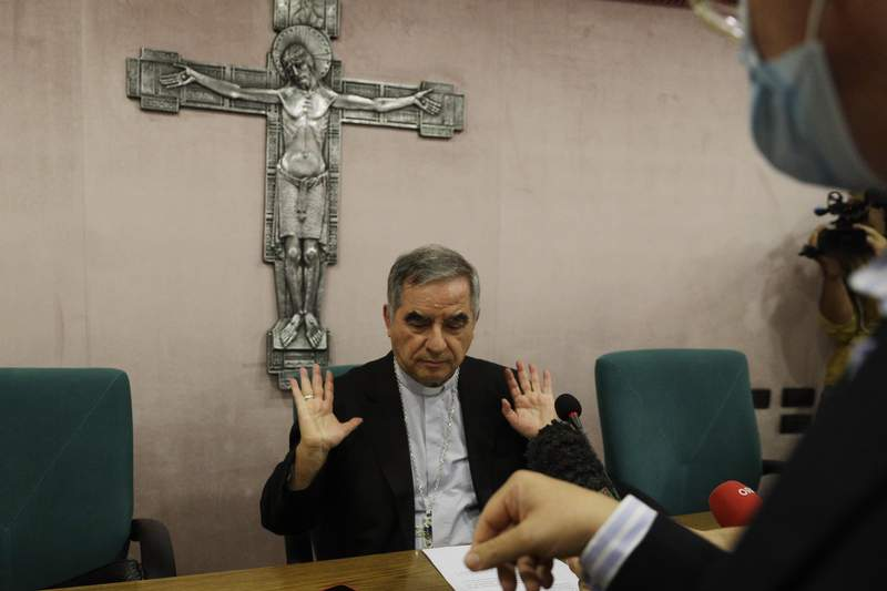 FILE - In this Sept. 25, 2020 Cardinal Angelo Becciu talks to journalists during a press conference in Rome. Italys financial police said Wednesday, Oct. 14, 2020 that a Sardinian woman, Cecilia Marogna, said to be close to one of the Holy Sees most powerful cardinals, Becciu, before his downfall, was arrested in Milan, northern Italy, late Tuesday on an international warrant issued by the Vatican City State. (AP Photo/Gregorio Borgia, file)