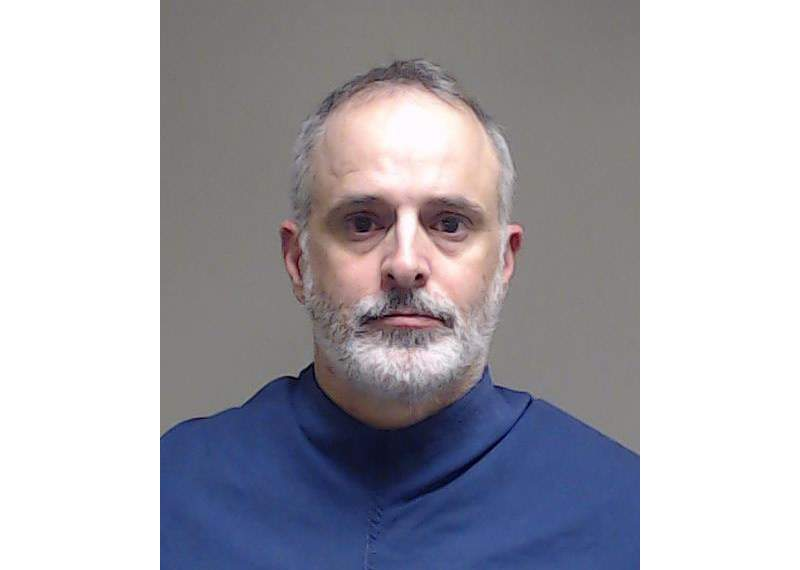 A photo provided by the Collin County Jail, in McKinney, Texas, shows Daniel Ray Caldwell. Caldwell was arrested Wednesday, Feb. 10, 2021, after he was charged with participating in the Jan. 6 assault on the U.S. Capitol. Court papers filed Tuesday in federal district court in Sherman, Texas, charge Caldwell, 49, with assaulting a federal officer, as well as with trespassing on restricted grounds, the violent entry on those grounds and participating in civil disorder.