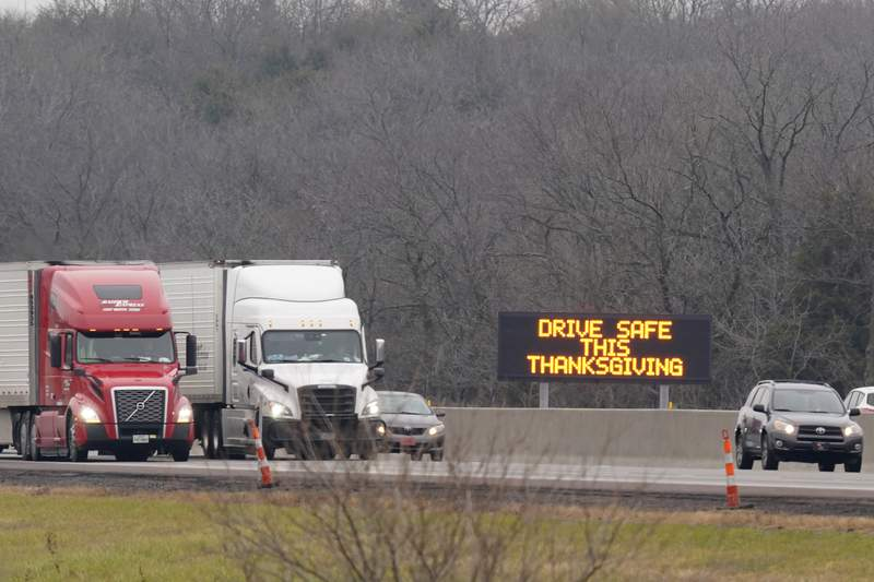 Vehicles travel in advance of Thanksgiving along I-70 near Lawrence, Kan., Wednesday, Nov. 25, 2020. Millions of Americans took to the skies and the highways ahead of Thanksgiving at the risk of pouring gasoline on the coronavirus fire, disregarding increasingly dire warnings that they stay home and limit their holiday gatherings to members of their own household. (AP Photo/Orlin Wagner)