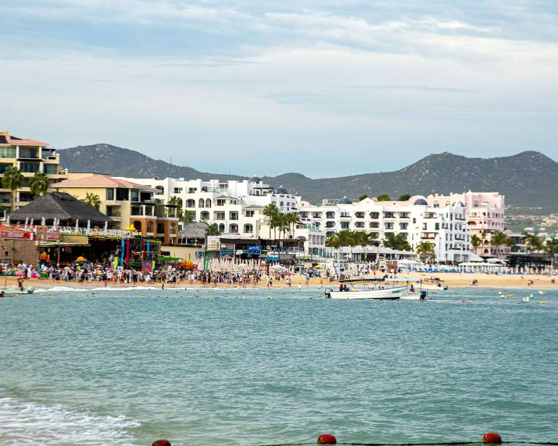 People walk on the beach in Cabo San Lucas, Mexico, on March 23.